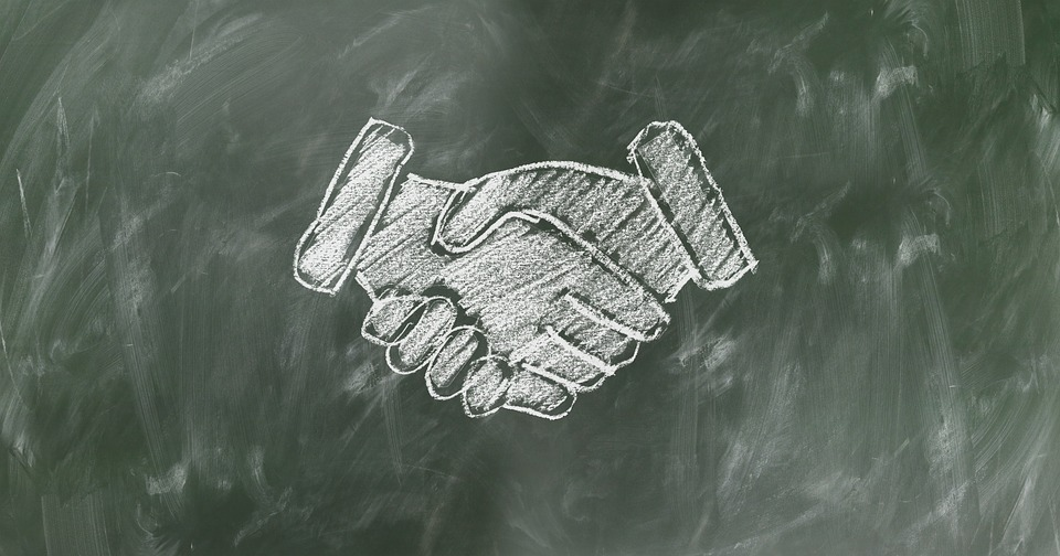Chalkboard handshake drawing employee