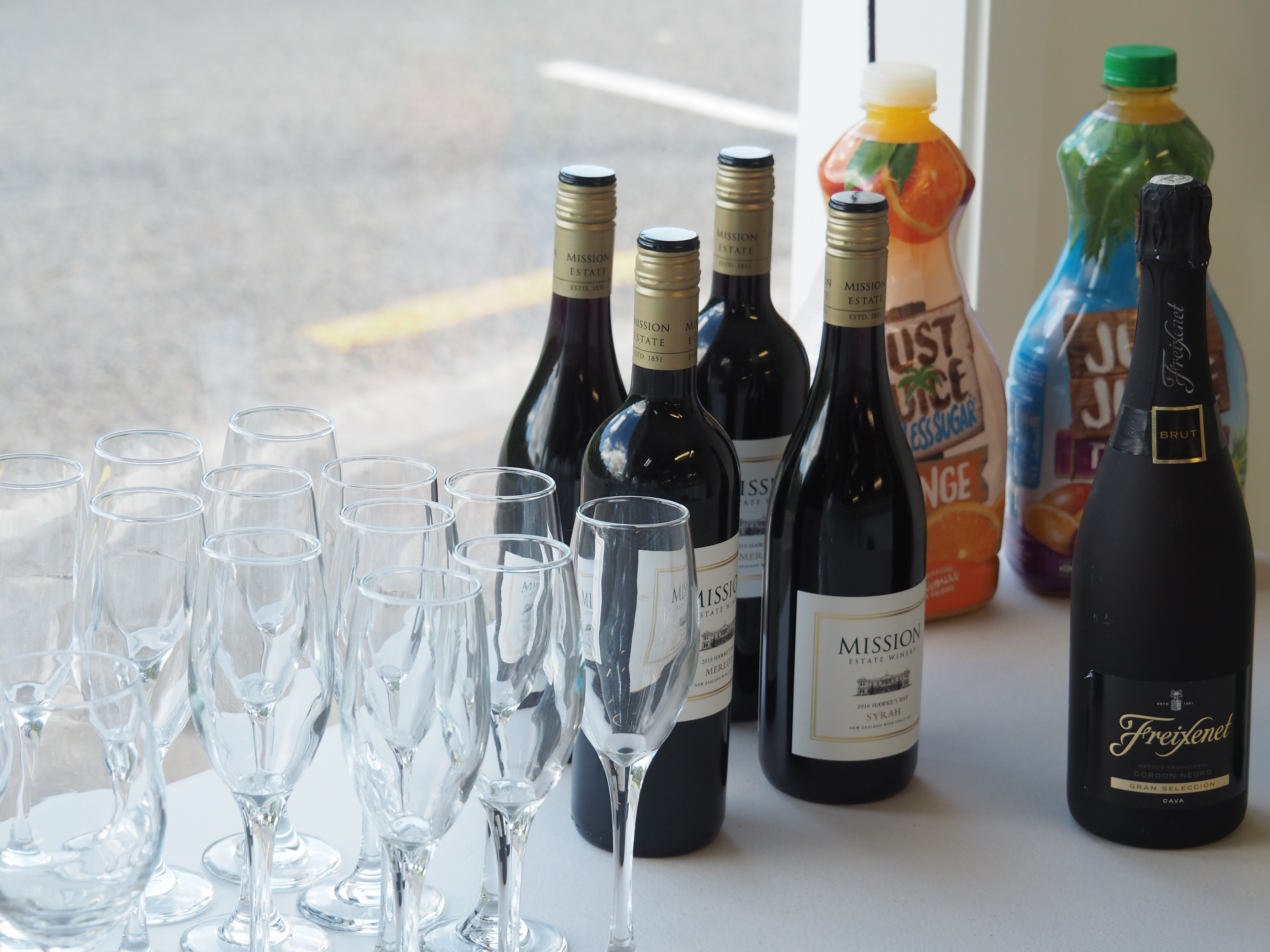 Bar with wine, juice and glasses