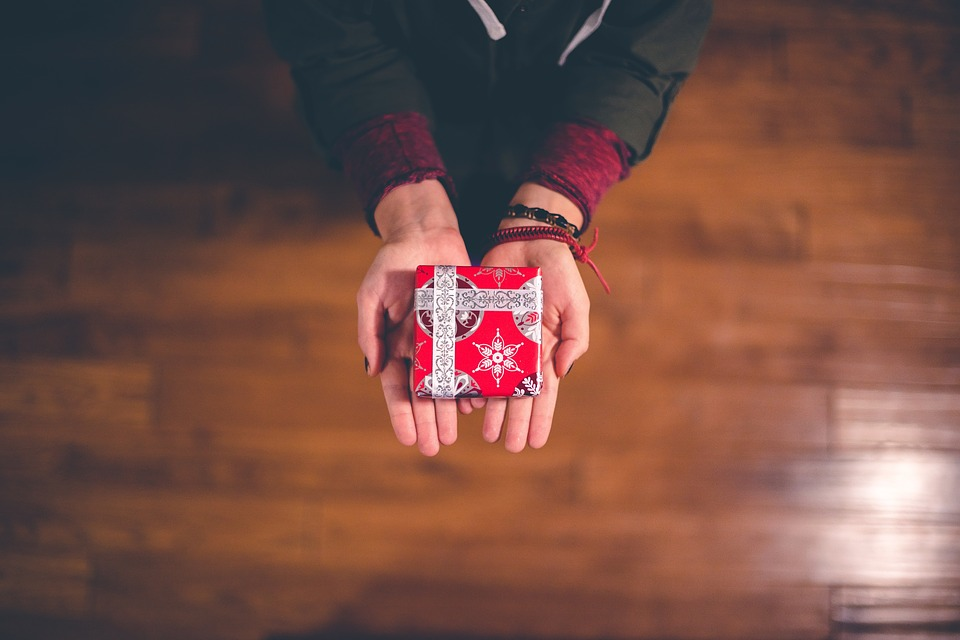 Person with Christmas gift