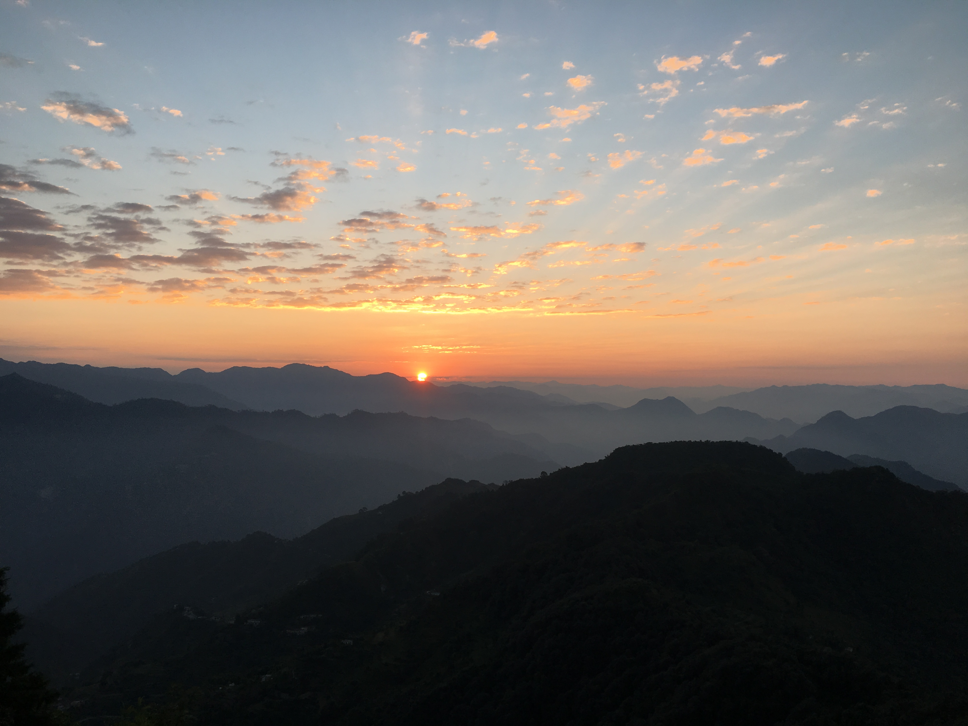 The sun rising over the Himalayas